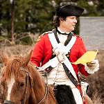 Man dressed in a Revolutionary soldier costume on a horse