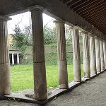 Columns next to a open courtyard